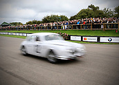 10th September 2017, Goodwood Estate, Chichester, England; Goodwood Revival Race Meeting; Goodwood spectators watch on as a Jaguar mk1 races by