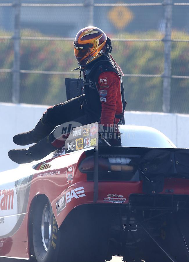 Feb 8, 2014; Pomona, CA, USA; NHRA top alcohol funny car driver Sean Bellemeur during qualifying for the Winternationals at Auto Club Raceway at Pomona. Mandatory Credit: Mark J. Rebilas-