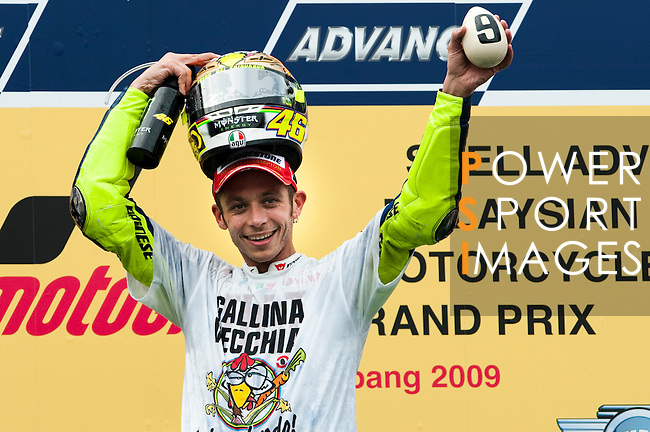KUALA LUMPUR, MALAYSIA - OCTOBER 25:  Fiat Yamaha Team rider Valentino Rossi of Italy celebrates on the podium after winning his ninth MotoGP World Championship title with his third place in the Malaysian MotoGP, which is round 16 of the MotoGP World Championship at the Sepang Circuit on October 25, 2009 in Kuala Lumpur, Malaysia. Photo by Victor Fraile / The Power of Sport Images