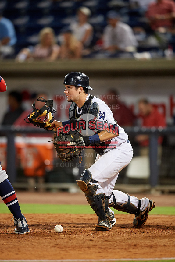 Pensacola Blue Wahoos Shrimp catcher Chris Okey (5) checks a runner while he recovers a loose ball during a game against the Jacksonville Jumbo on August 15, 2018 at Blue Wahoos Stadium in Pensacola, Florida.  Jacksonville defeated Pensacola 9-2.  (Mike Janes/Four Seam Images)