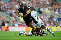 Tom Lindsay of London Wasps is tackled by Jordan Turner-Hall (right) and Nick Easter of Harlequins during the Aviva Premiership match between London Wasps and Harlequins at Twickenham on Saturday 1st September 2012 (Photo by Rob Munro).