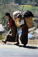 February 1975, Pokhara area, Nepal. Daily life. The Nepalese are use to carry heavy load on their back.