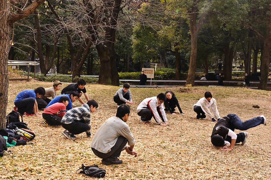 "Parkour instructor Jun ""Sullivan"" Sato demonstrates a roll. Parkour Tokyo group practice, Shinjuku Chuo Koen, Tokyo, Japan, January 15, 2012. Parkour is a modern method of physical training, also known as freerunning. It was founded in France in the 1990s. There is a small group of around 50 parkour practitioners in Tokyo."
