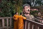 _DSC1106, Vacheron, China, 02/2016, CHINA-10344. Two monks overlook a large statue of Buddha.<br /> <br /> CHECK IMAGE USAGE<br /> <br /> FINAL_Vacheron<br /> <br /> retouched_Sonny Fabbri and Ekaterina Savtsova 06/09/2016