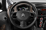 Car pictures of steering wheel view of a 2016 Citroen C-Zero Confort 5 Door Micro Car Steering Wheel