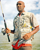 USA, Florida, man holding fishing rod, Ivory Keys