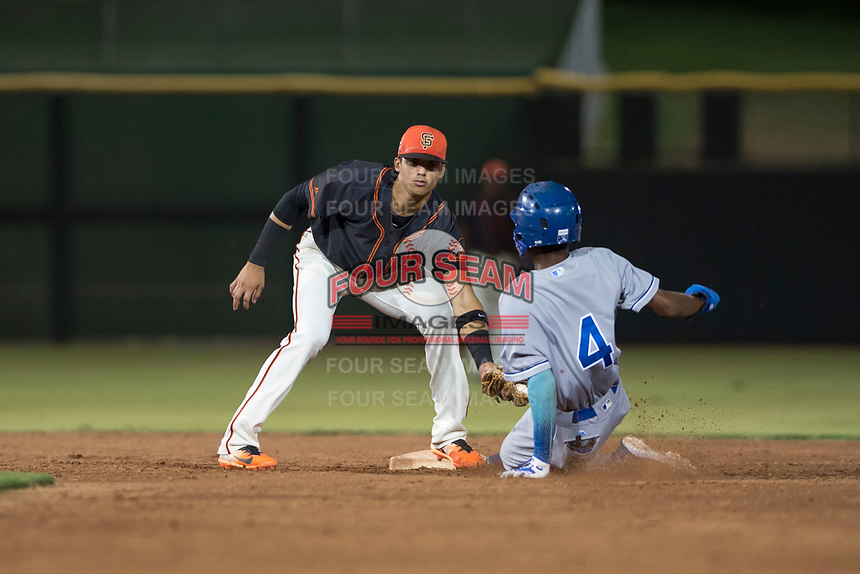 AZL Giants Black shortstop Abdiel Layer (17) applies the tag to Maikel Garcia (4) on a stolen base attempt during an Arizona League game against the AZL Royals at Scottsdale Stadium on August 7, 2018 in Scottsdale, Arizona. The AZL Giants Black defeated the AZL Royals by a score of 2-1. (Zachary Lucy/Four Seam Images)