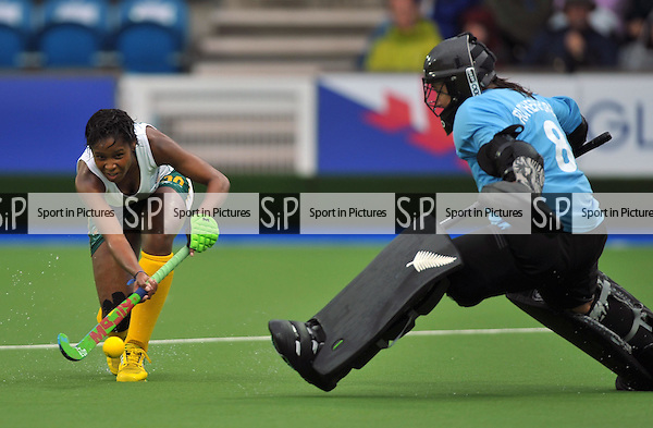 Sulette Damons (RSA) puts the ball past Sally Rutherford (NZL goalkeeper). South Africa (RSA) v New Zealand (NZL). Womens bronze medal match. Hockey. PHOTO: Mandatory by-line: Garry Bowden/SIPPA/Pinnacle - Tel: +44(0)1363 881025 - Mobile:0797 1270 681 - VAT Reg No: 183700120 - 020814 - Glasgow 2014 Commonwealth Games - Glasgow national hockey centre, Glasgow, Scotland, UK