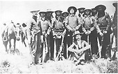 Jicarilla Apache indian trader Emmet Wirt and Jicarilla Apache police with their Winchester rifles.<br /> Dulce, NM  ca. 1900