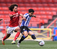 28th June 2020; Ashton Gate Stadium, Bristol, England; English Football League Championship Football, Bristol City versus Sheffield Wednesday; Kadeem Harris of Sheffield Wednesday holds off the chllenge from Han-Noah Massengo of Bristol City