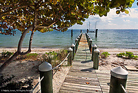 Private dock leading into ocean, Florida