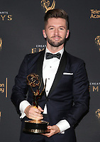 LOS ANGELES, CA - SEPTEMBER 09: Travis Wall, at the 2017 Creative Arts Emmy Awards- Press Room at Microsoft Theater on September 9, 2017 in Los Angeles, California. <br /> CAP/MPIFS<br /> &copy;MPIFS/Capital Pictures