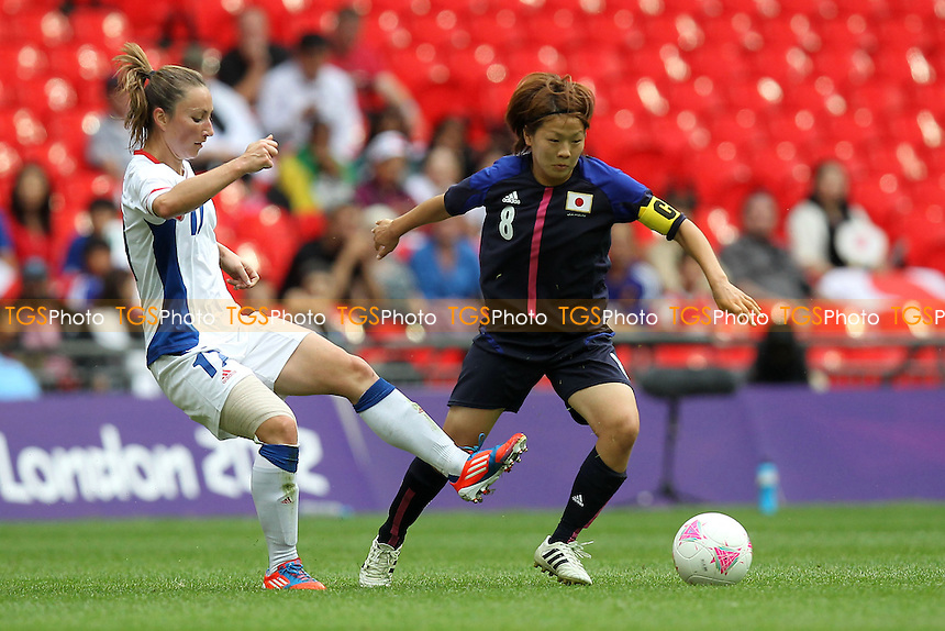 Aya MIYAMA of Japan evades Gaetane THINEY of France - France Women vs Japan Women - Womens Olympic Football Tournament London 2012 Semi-Final at Wembley Stadium - 06/08/12 - MANDATORY CREDIT: Gavin Ellis/SHEKICKS/TGSPHOTO - Self billing applies where appropriate - 0845 094 6026 - contact@tgsphoto.co.uk - NO UNPAID USE.