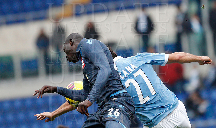 Calcio, Serie A: Lazio vs Napoli. Roma, stadio Olimpico, 18 gennaio 2015.<br /> Napoli&rsquo;s Kalidou Koulibaly, left, and Lazio&rsquo;s Lorik Cana jump for the ball during the Italian Serie A football match between Lazio and Napoli at Rome's Olympic stadium, 18 January 2015.<br /> UPDATE IMAGES PRESS/Riccardo De Luca