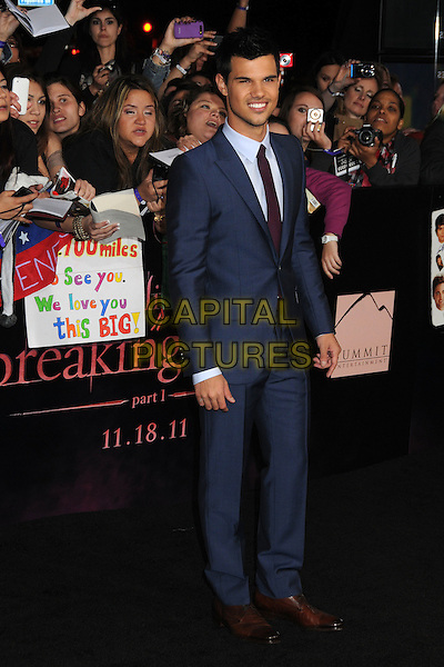 Taylor Lautner.The Los Angeles premiere of 'The Twilight Saga Breaking Dawn Part 1' at Nokia Theatre at L.A. Live in Los Angeles, California, USA..November 14th, 2011.full length suit blue purple tie .CAP/ADM/BP.©Byron Purvis/AdMedia/Capital Pictures.
