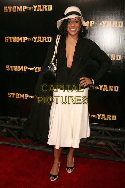 "ESSENCE ATKINS.""Stomp The Yard"" Los Angeles Premiere at Arclight Cinemas, Hollywood, California, USA, 8 January 2007..full length black top low cut plunging neckline hat hand on hip.CAP/ADM/BP.©Byron Purvis/AdMedia/Capital Pictures."