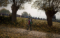 a mechanic walks up the Koppenberg between races<br /> <br /> 25th Koppenbergcross 2016