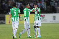 MEDELLÍN -COLOMBIA-16-02-2014. Fernando Uribe de Atlético Nacional celebra  gol en contra del Deportes Tolima durante partido por la fecha 5 de la Liga Postobón I 2014 jugado en el estadio Atanasio Girardot de la ciudad de Medellín./ Atletico Nacional Player Fernando Uribe celebrates a goal against Deportes Tolima player xxx (R) during match for the fifth date of the Postobon League I 2014 at Atanasio Girardot stadium in Medellin city. Photo: VizzorImage/Luis Ríos/STR