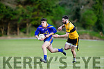Mike Breen Beaufort is tracked by Denis Walsh Listowel Emmets during their their JC replay in Beaufort Saturday evening