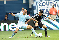 Kansas City defender Aurelien Collin (78) fights for the ball with San Jose forward  Cesar Diaz Pizarro (27)... Sporting Kansas City defeated San Jose Earthquakes 2-1 at LIVESTRONG Sporting Park, Kansas City, Kansas.