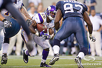 Minnesota Vikings running back Adrian Peterson (28) looks past Seattle Seahawks defensive tackle Ryan Sims (97) while running upfield at CenturyLink Field in Seattle, Washington. The Minnesota Vikings won the game, 20-7.