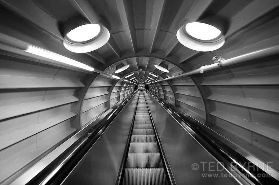 View of an escalator descending between spheres of the Atomium in Brussels, Belgium