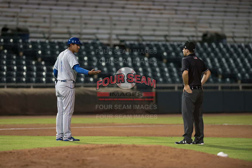 AZL Royals manager Tony Pena Jr (1) argues a call from field umpire Hector Cuellar during an Arizona League game against the AZL Giants Black at Scottsdale Stadium on August 7, 2018 in Scottsdale, Arizona. The AZL Giants Black defeated the AZL Royals by a score of 2-1. (Zachary Lucy/Four Seam Images)