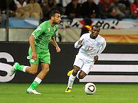 Shaun Wright-Phillips of England and Nadir Belhadj of Algeria