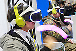 Visitors test the virtual reality headset PlayStation VR during the Anime Japan 2016 in Tokyo Big Sight on March 26, 2016, Tokyo, Japan. Anime Japan 2016 is the world's biggest exhibition promoting all aspects of the Anime industry to local and foreign fans and business investors. The exhibition is held over three days until March 27 and is expected to attract some 120,000 visitors, many wearing cosplay. (Photo by Rodrigo Reyes Marin/AFLO)