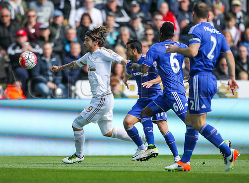 09.04.2016. Liberty Stadium, Swansea, Wales. Barclays Premier League. Swansea versus Chelsea. Swansea City's Alberto Paloschi holds off the challenge from Chelsea's Pedro