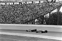 INDIANAPOLIS, IN - MAY 26: Mario Andretti drives his Newman Haas Racing Lola T900 HU21/Cosworth ahead of eventual winner Danny Sullivan in the March 85C 37/Cosworth during the Indianapolis 500 USAC IndyCar race at the Indianapolis Motor Speedway in Indianapolis, Indiana, on May 26, 1985.