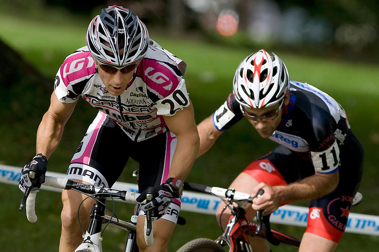 September 26, 2010 - Leading the race, Canadian cyclist Derrick St. John rounds a corner, followed by US cyclist Justin Lindine in the Union Cycliste Internationale cyclocross race at Ellison Park. Lindine later passes St. John, winning the race, while St. John finishes second.