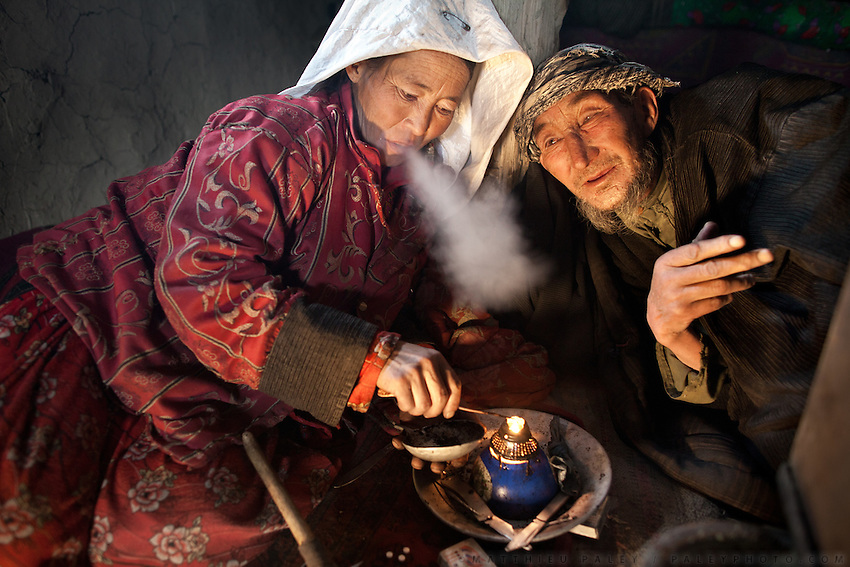 Khaltcha and Abdul Muttalib smoke opium several times a day - like approximately 20% of the Kyrgyz. ?We started smoking when we lost our first child? says Abdul, ?Every year, one of our children would die? - often from diseases easily treatable elsewhere. Only one, a son, survived to age five. Then he, too, passed away. ?We lost 11 children, we are unlucky?. In the Pamir, it is not unusual for parents to lose six or seven children. Most Kyrgyz are extremely unsentimental about death and dying and accept it as an unavoidable part of life. In 2007, Alex Duncan, a British doctor, collected data in the Afghan Pamir and established that child-under-five mortality there was 520 deaths per 1,000 live births (52% mortality), the world's highest rate. Main reasons to this are the intense isolation, the high altitude environment and no access to doctors or health clinics...The Kyrgyz settlement of Tchelab, near Chaqmaqtin lake, Haji Bootoo Boi's camp...Trekking through the high altitude plateau of the Little Pamir mountains, where the Afghan Kyrgyz community live all year, on the borders of China, Tajikistan and Pakistan.