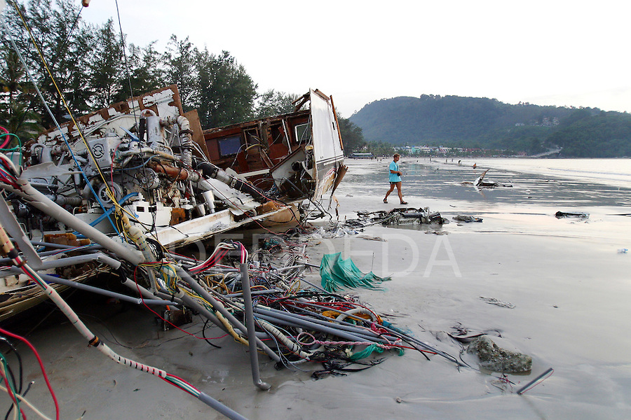 A gutted boat on Patong Beach the day after the tsunami hit the area. On December 26, 2004, a major earthquake generated tsunamis that ravaged coastlines from Southeast Asia to Africa. Approximately 275,000 people were killed and tens of thousands were left homeless, making it one of the deadliest natural disasters in modern history. ..