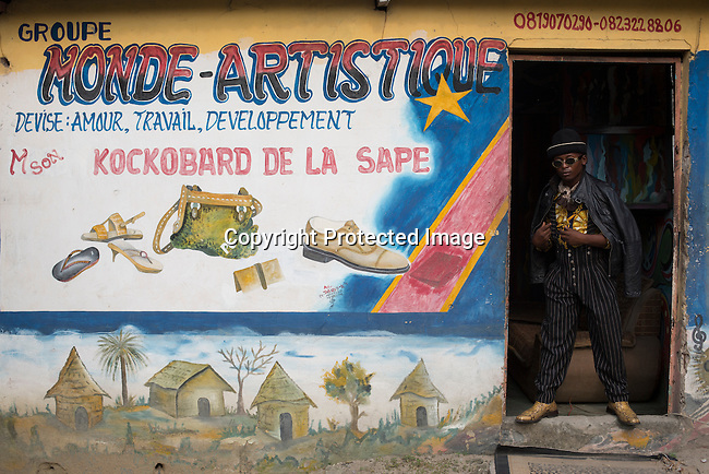 """KINSHASA, DEMOCRATIC REPUBLIC OF CONGO - FEBRUARY 13: A Sapeur from the group belonging to Papa Griffe poses for a portrait February 13, 2016 in Kinshasa, DRC. The word Sapeur comes from SAPE, a French acronym for Société des Ambianceurs et Persons Élégants. or Society of Revellers and Elegant People. and it also means, .to dress with elegance and style"""". Most of the young Sapeurs are unemployed, poor and live in harsh conditions in Kinshasa, a city of about 10 million people. For many of them being a Sapeur means they can escape their daily struggles and dress like fashionable Europeans. Many hustle to build up their expensive collections. Most Sapeurs could never afford to visit Paris, and usually relatives send or bring clothes back to Kinshasa. (Photo by Per-Anders Pettersson)"""