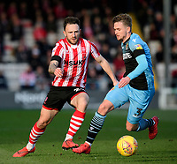 Lincoln City's Neal Eardley vies for possession with Stevenage's Johnny Hunt<br /> <br /> Photographer Chris Vaughan/CameraSport<br /> <br /> The EFL Sky Bet League Two - Lincoln City v Stevenage - Saturday 16th February 2019 - Sincil Bank - Lincoln<br /> <br /> World Copyright © 2019 CameraSport. All rights reserved. 43 Linden Ave. Countesthorpe. Leicester. England. LE8 5PG - Tel: +44 (0) 116 277 4147 - admin@camerasport.com - www.camerasport.com