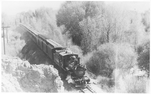 Elevated panoramic view of C-19 #340 with a 10-car passenger train.<br /> D&amp;RGW