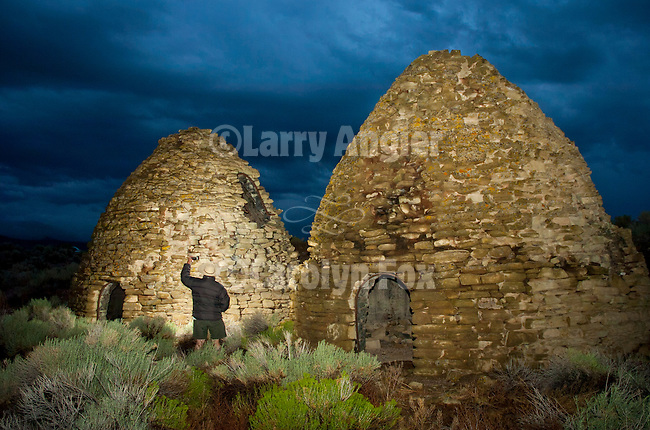 Three bee hive charcoal ovens, dusk, storm at the ghost town of Bristol Wells, Nev.