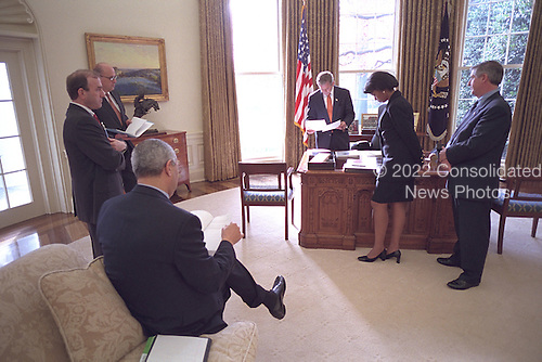 United States President George W. Bush meets with White House staff shortly before meeting with the United Nations Secretary General Kofi Annan Nov. 28.  Visible in the photo are U.S. Secretary of State Colin Powell, National Security Advisor Condoleezza Rice, and White House Chief of Staff Andrew Card..Mandatory Credit: Eric Draper - White House via CNP.