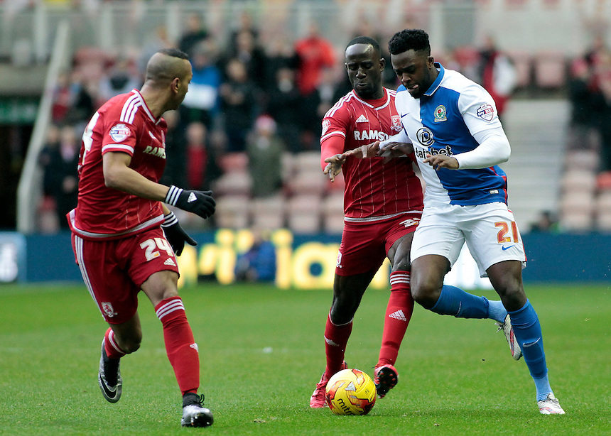 Blackburn Rovers' Hope Akpan pushes forward past Middlesbrough's Albert Adomah &amp; Emilio Nsue (left)<br /> <br /> Photographer David Shipman/CameraSport<br /> <br /> Football - The Football League Sky Bet Championship - Middlesbrough v Blackburn Rovers - Saturday 6th February 2016 - Riverside Stadium - Middlesbrough <br /> <br /> &copy; CameraSport - 43 Linden Ave. Countesthorpe. Leicester. England. LE8 5PG - Tel: +44 (0) 116 277 4147 - admin@camerasport.com - www.camerasport.com