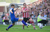 Lincoln City's Harry Toffolo vies for possession with Tranmere Rovers' Kieron Morris<br /> <br /> Photographer Chris Vaughan/CameraSport<br /> <br /> The EFL Sky Bet League Two - Lincoln City v Tranmere Rovers - Monday 22nd April 2019 - Sincil Bank - Lincoln<br /> <br /> World Copyright © 2019 CameraSport. All rights reserved. 43 Linden Ave. Countesthorpe. Leicester. England. LE8 5PG - Tel: +44 (0) 116 277 4147 - admin@camerasport.com - www.camerasport.com