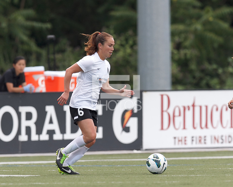 Portland Thorns FC midfielder Meleana Shim (6) brings the ball forward.  In a National Women's Soccer League (NWSL) match, Portland Thorns FC (white/black) defeated Boston Breakers (blue), 2-1, at Dilboy Stadium on July 21, 2013.