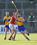jack Browne of Clare in action against Lorcan Mc Loughlin of Cork during their Munster Hurling League game at Cusack Park. Photograph by John Kelly.