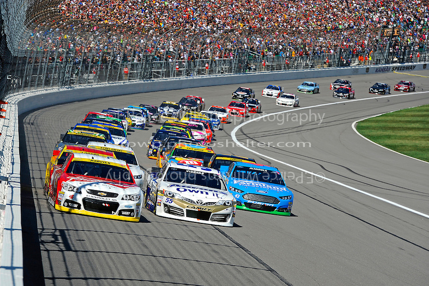 Kevin Harvick (#4) , Brian Vickers, (#55) and Aric Almirola (#43)