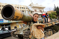 Photographer: Rick Findler..06.10.12 Young boys play on a destroyed tank in the Syrian towen of Azaz. The town suffered catastrophic damage two weeks ago at the hands of President Assad's fighterjets and helicport gunships.
