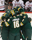 The Catamounts celebrate Mike Paliotta's (UVM - 2) goal which gave them a 1-0 lead late in the first period. - The visiting University of Vermont Catamounts defeated the Northeastern University Huskies 6-2 on Saturday, October 11, 2014, at Matthews Arena in Boston, Massachusetts.