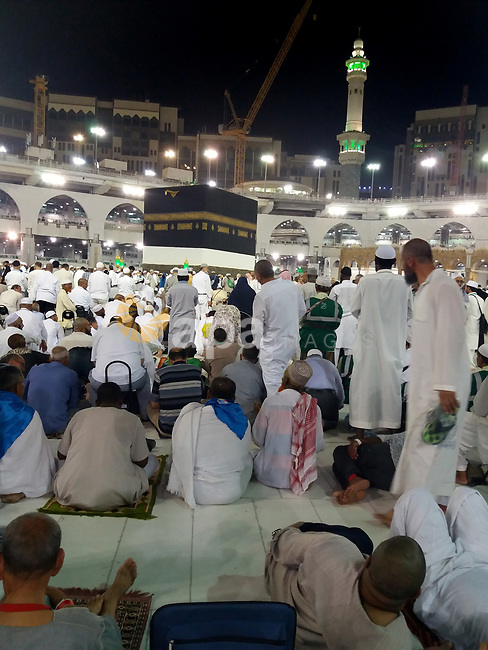 Muslim pilgrims pray around the holy Kaaba at the Grand Mosque, during the annual haj pilgrimage in Mecca August 21, 2017. According to the Muslims holy book the Koran, the Kaaba was built by Abraham and his son Ismael, after Ismael had settled in Arabia. Millions of Muslims have arrived in Saudi Arabia to perform their Haj. Photo by Mohammed Hassan