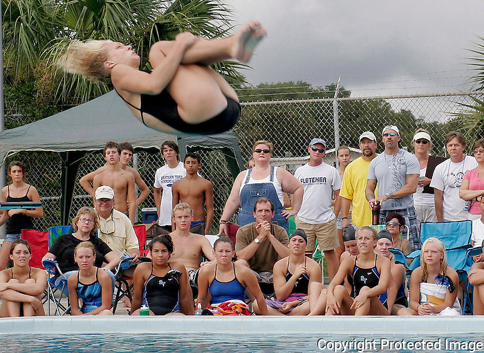 Gary Wilcox/StaffÉ08/29/07 ...Fletcher High School swim team diver Emily Padgett makes a dive during the Bartram Trail High at Fletcher High Swim and Dive meet last Saturday (08/25/07) at Fletcher High..
