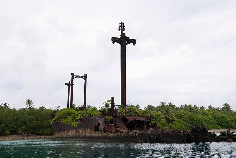A rusted battleship -- a rememant of the Pacific War -- rusts slowly into the Jaluit Lagoon at Imej, Jaluit Atoll, Marshall Islands