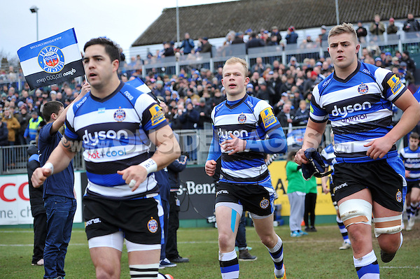 Will Homer and the rest of the Bath Rugby team run out onto the field. LV= Cup match, between Bath Rugby and the Ospreys on February 7, 2015 at the Recreation Ground in Bath, England. Photo by: Patrick Khachfe / Onside Images
